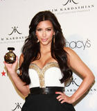 th_86852_celebrity_paradise.com_Kim_Kardashian_Fragance_57_122_32lo.jpg