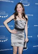 http://img273.imagevenue.com/loc421/th_751808223_Rose_McGowan_Millennium_Network_Event_in_Hollywood_March_17_2011_04_122_421lo.jpg